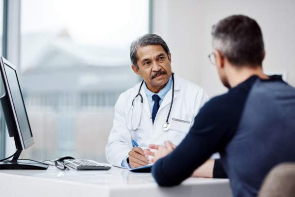 man talking to doctor