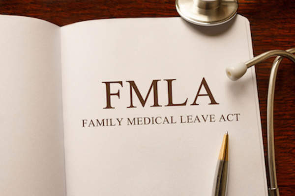 FMLA law book concept, know your rights.