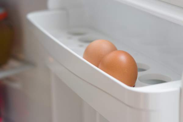 Eggs in refrigerator door.
