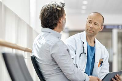 Doctor discussing treatment with a patient.