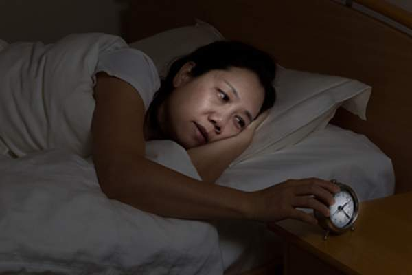 Mature woman restless at night time