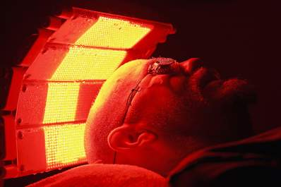 Man undergoing phototherapy treatment for psoriasis.