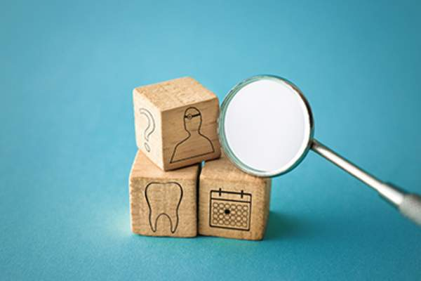 Dental appointment concept in blocks.