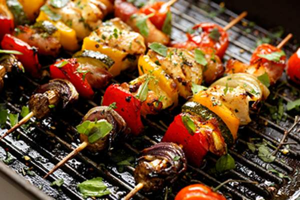 Vegetable and meat skewers in a herb marinade