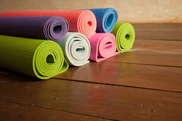 Colorful rolled yoga mats.