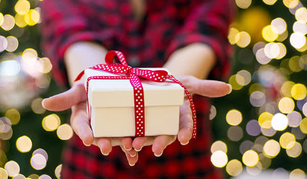 Close up of woman holding gift box.