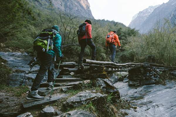 People hiking along a mountain path.