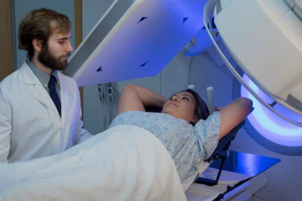 Doctor setting up patient for radiation therapy