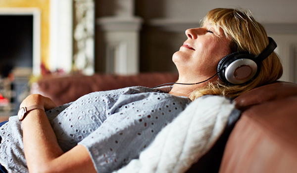 woman relaxing to music image