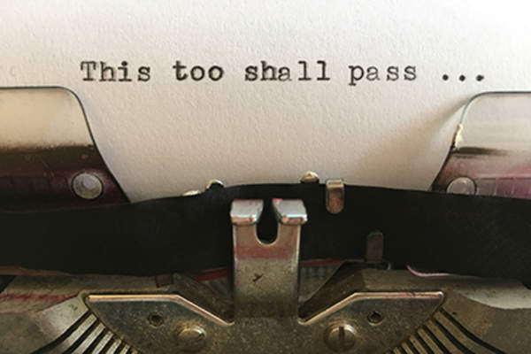 """This too shall pass"" written on a typewriter."