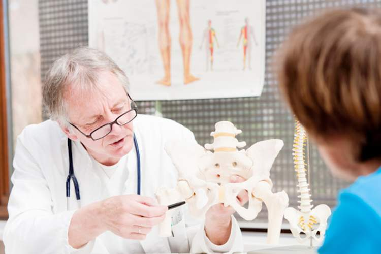 Doctor explaining arthritis to a patient.