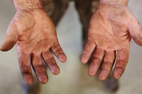 Dirt covered hands.