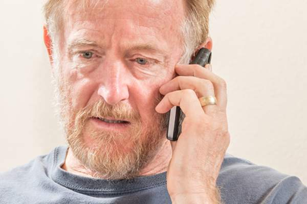 Older man on the telephone image.