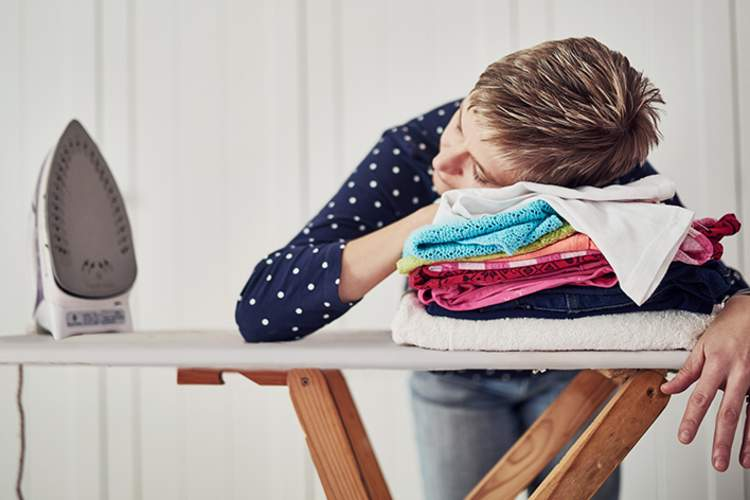 Exhausted woman doing her ironing.