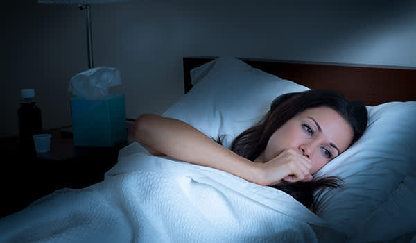 woman coughing at night image