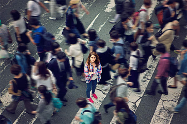 Person in a crowd on a busy street.