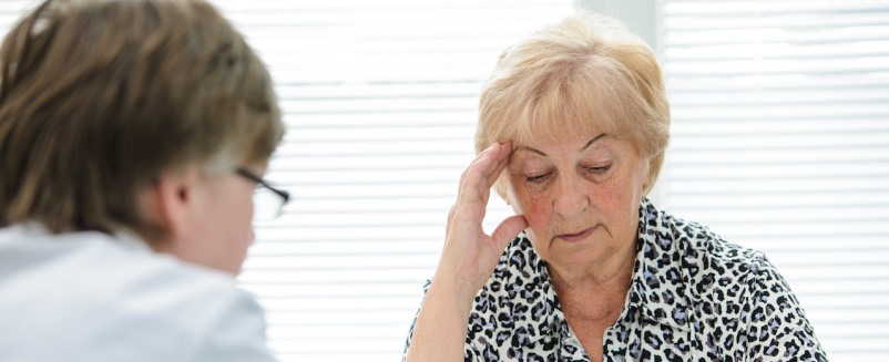 older woman talking with doctor