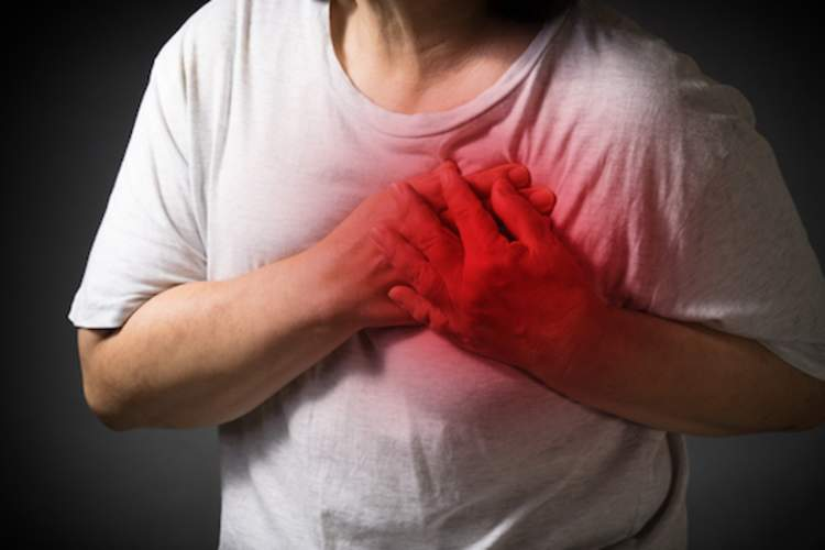 Woman grabbing chest, red highlighted pain.
