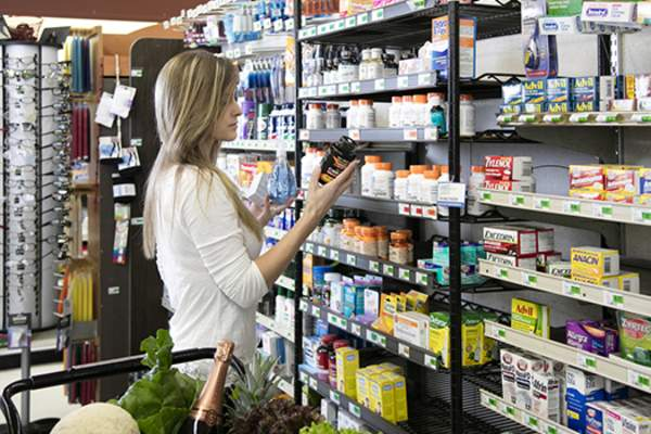 Woman shopping for supplements image.