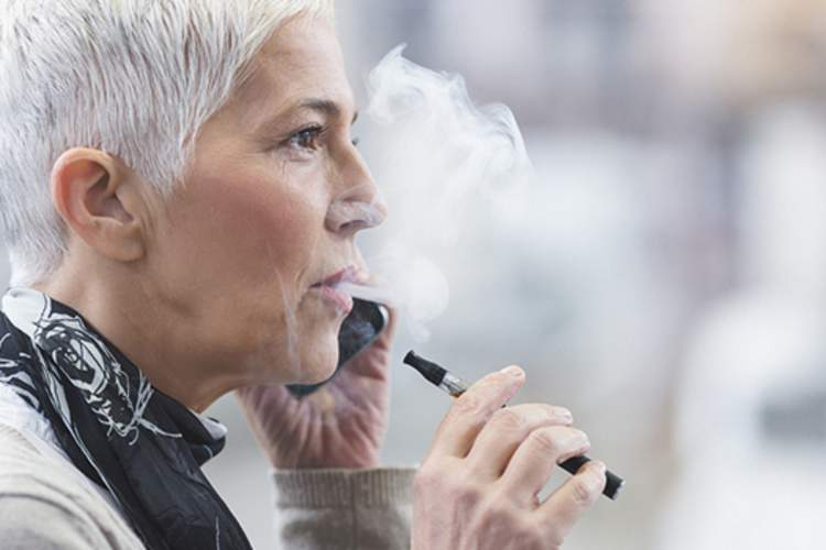 Woman with electronic cigarette.