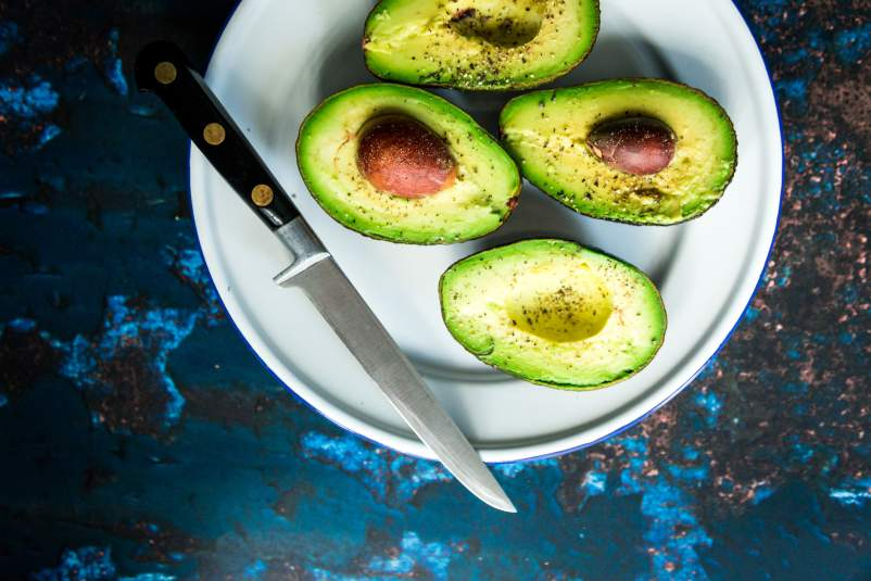 Cut avocados on a plate.