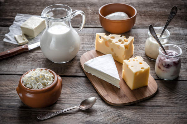 Dairy products on rustic table.