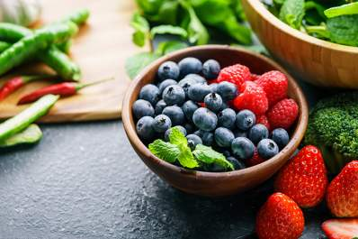 Strawberries, blueberries, and broccoli that are high in flavonoids.