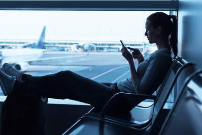 Woman travelling, waiting at airport