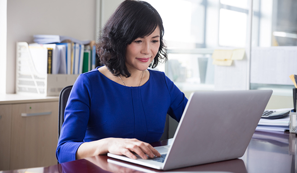 Adult woman on laptop computer.
