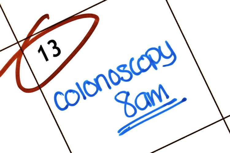 Colonoscopy appointment reminder written on calendar.