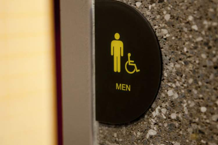 restroom sign of man really having to go