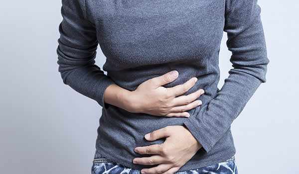 Woman experiencing stomach pain.