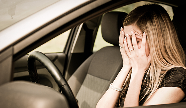 Woman having a panic attack in her car