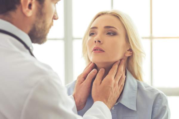 Woman getting thyroid check