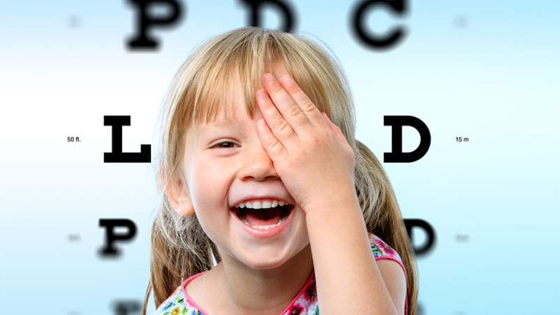 Happy young girl at eye exam.