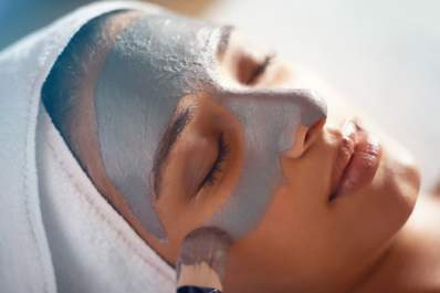Skin care concept, woman getting mask applied at spa.