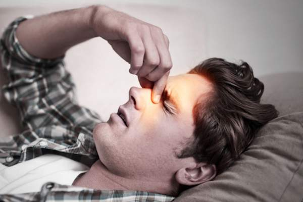 Man dealing with sinus infection.