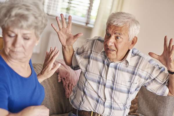 Angry senior man yelling at wife image.