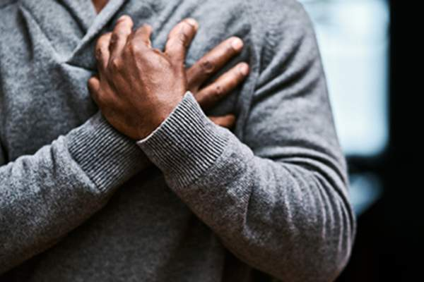 Man experiencing chest pain from heart failure.