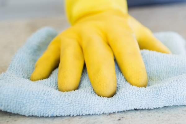 Cleaning with gloves.