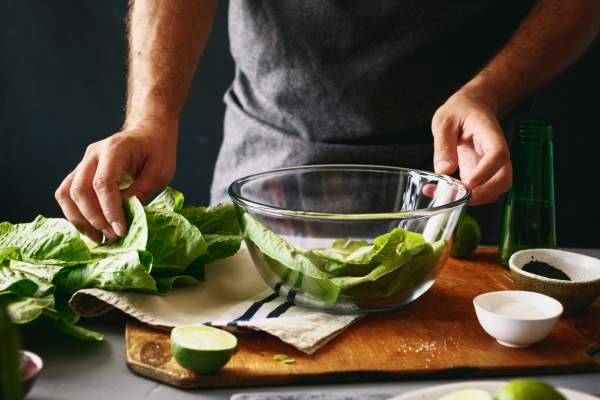 man making green salad
