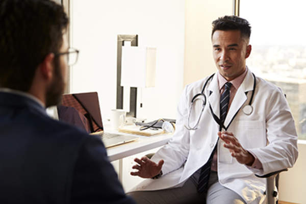 General practitioner explaining information to a patient.