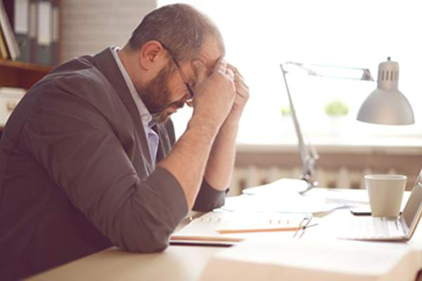 Man stressed while working in an office