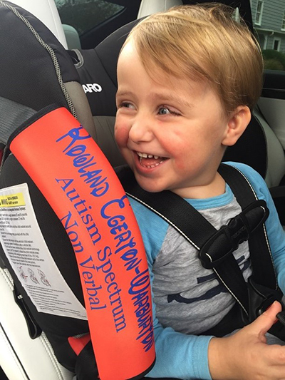 Roly in his new seatbelt in case of emergency for non-verbal children, 2017