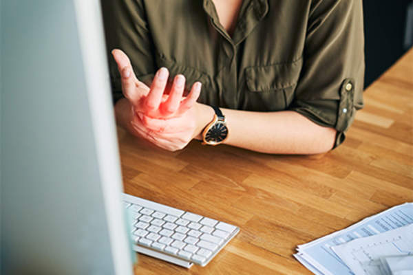 Woman with wrist pain at work.