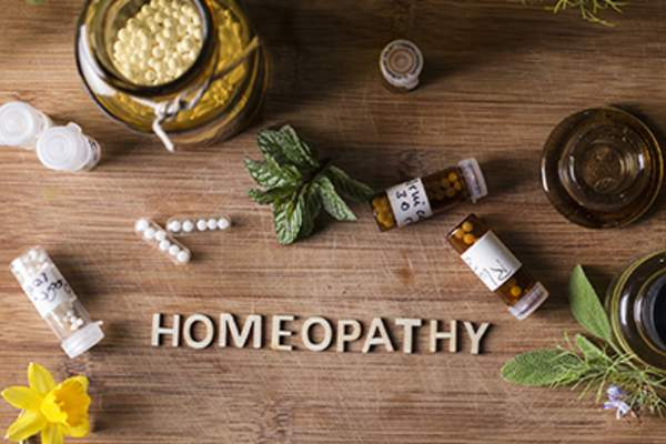 Homeopathy globules and bottles.