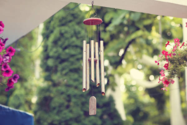 Wind chimes on a porch.