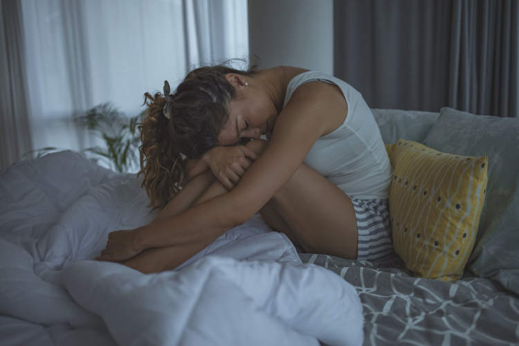 Woman with insomnia can't fall asleep