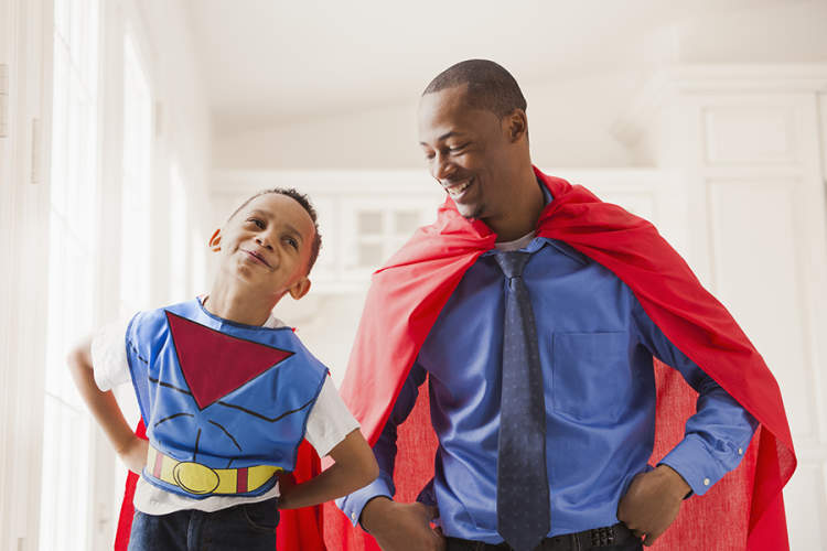 Father and son dressed up as superheroes