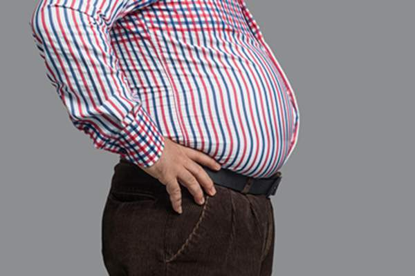 Side view of an overweight man's gut.